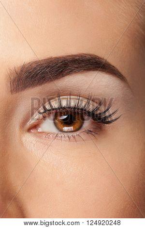 Woman With Fake Eyelashes And No Make Up