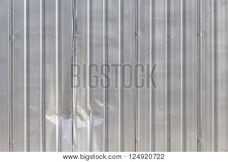background of damage corrugated fence at exterior of construction site