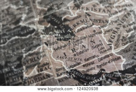 Iran map on vintage crack paper background selective focus