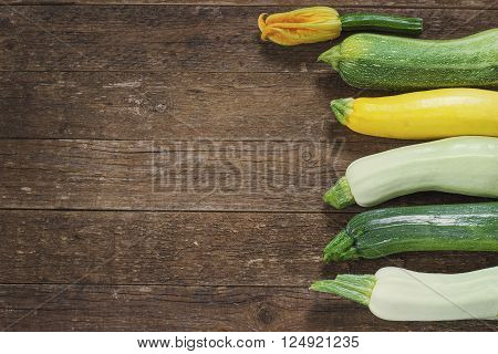 Fresh organic zucchini on the wooden table toning