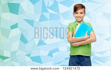 childhood, school, education and people concept - happy smiling student boy with folders and notebooks over blue low poly texture background