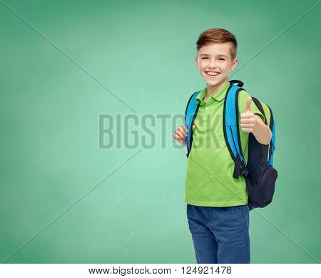 childhood, education and people concept - happy smiling student boy with school bag over green school chalk board background