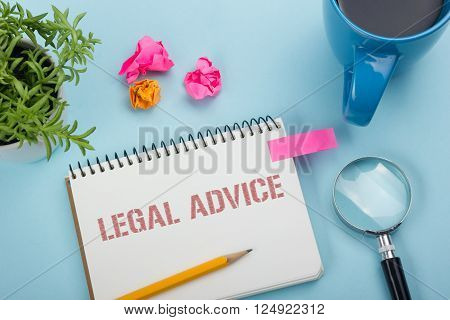Legal Advice. Notepad with message, coffee cup, pen and flower. Office supplies on desk table top view.