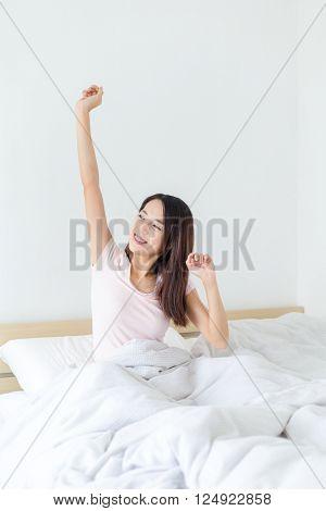 Young woman wake up at morning