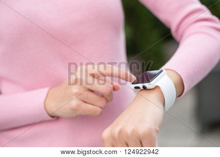 Woman touch on the screen of smart watch
