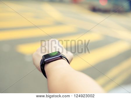 Man using smart watch at outdoor