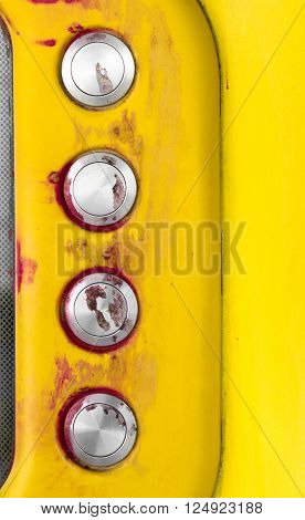 Details of a yellow intercom with disturbing traces of blood on the call keys.