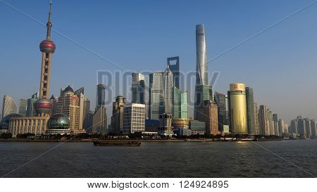 SHANGHAI CHINA - JANUARY 19 2016: Shanghai Skyline with Pudong Huangpu River Oriental Pearl Tower Jin Mao Tower Shanghai International Finance Centre Shanghai World Financial Center