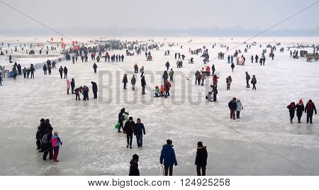 HARBIN CHINA - JANUARY 15 2016: Local life during the 32nd Harbin Ice Festival. The main attraction is the Harbin Ice and Snow World which covers more than 750000 square meters