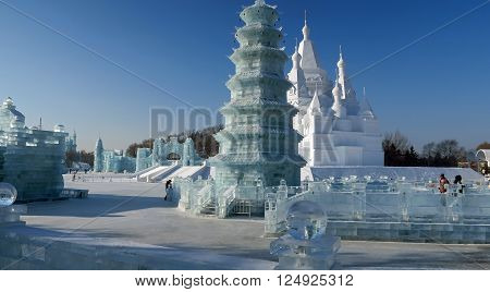 HARBIN CHINA - JANUARY 15 2016: Local life during the 32nd Harbin Ice Festival. The main attraction is the Harbin Ice and Snow World which covers more than 750000 square meters.