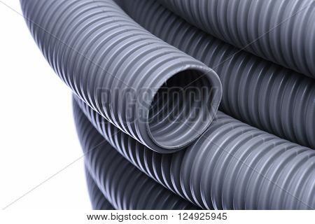 Corrugated pipe for installation of electrical cable isolated on white background