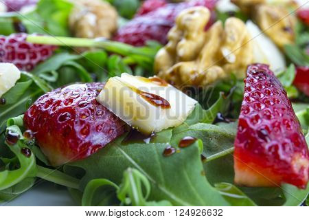 Spring Salad With Strawberries, Rocket Salad, Parmesan Cheese, Walnuts And Balsamic Vinegar