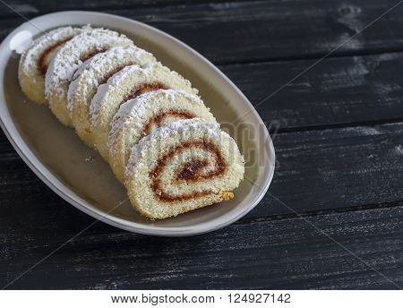 Sweet rolls with apple jam on a dark wooden background