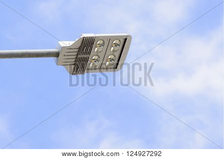 the LED street lamp belong the road with the sky