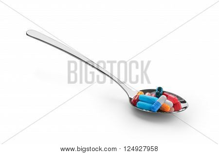 spoon with pills isolated on a white background