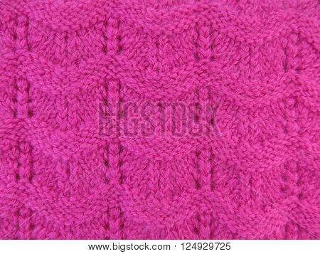 Macro texture of pink sweaters knitting handmade