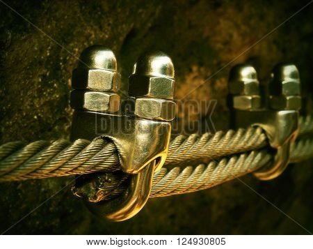 Detail Of Chrome Screws Snap Hooks And Grommets At And Of Rope. Iron Twisted Rope Fixed Together By