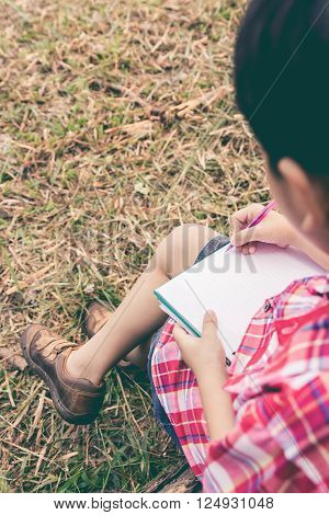 Back View. Boy Writing On Notebook. Education Concept. Vintage Style.