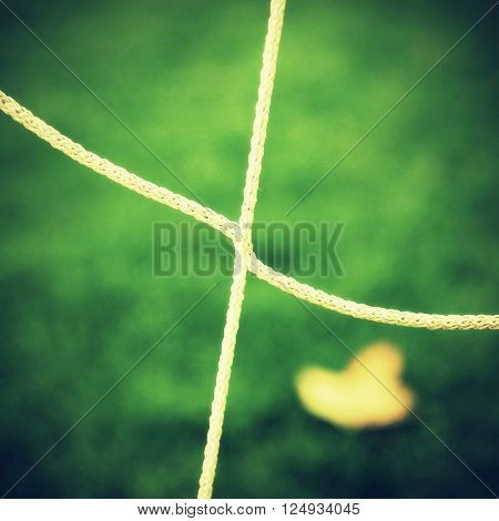 Detail Of Crossed Soccer Nets, Soccer Football In Goal Net With Plastic Grass On Football Playground