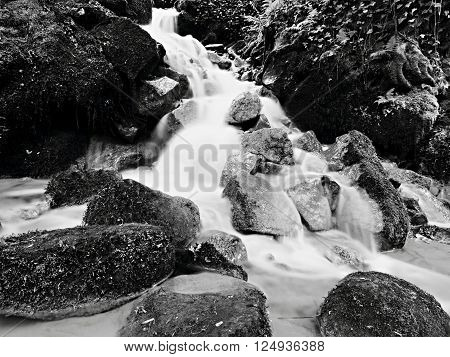 Cascade On Small Mountain Stream, Water Is Running Over Mossy Sandstone Boulders And Bubbles Create