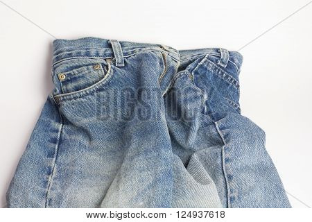 Fragment of blue jeans on a white background