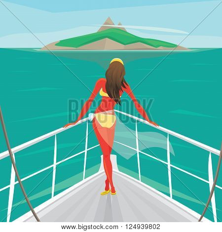 Beautiful girl in a swimsuit standing on the front of the boat deck and looks at an island in the distance. View from the back - Sea voyage or cruise concept