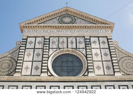 Florence, Italy-June 2, 2015. Exterior detail of the Basilica of Santa Maria Novella, situated just across from the main railway station which shares its name. Chronologically, it is the first great basilica in Florence, and is the city's principal Domini