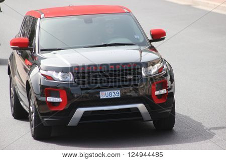 Monte-Carlo, Monaco - April 6, 2016: Land Rover Range Rover Evoque on Avenue d'Ostende in Monaco. Young Woman Driving a Red and Black Modern SUV in the south of France