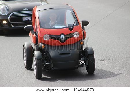 Monte-Carlo Monaco - April 6 2016: Red Electric Car Renault Twizy on Avenue d'Ostende in Monaco. Old Woman Driving an Electric Car Renault Twizy in the south of France