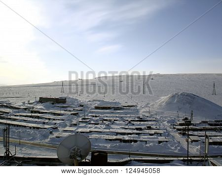 Winter landscape , snow-covered small buildings meteorological station