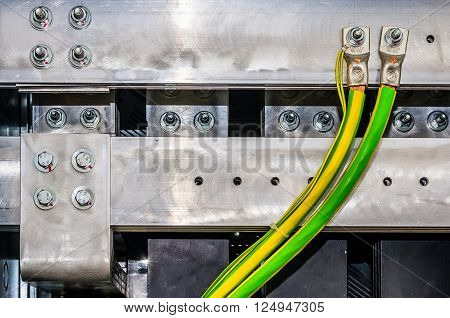 Closeup view on aluminum bars in electrical switchgear