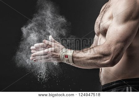 Close-up Photo Of A Muscular Torso And Hands Isolated On Black Background.