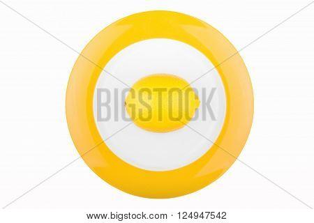 Fresh lemon on a plate isolated on white background