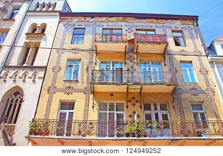 LVIV, UKRAINE - JUNE 30, 2014: Majolica House with its beautiful ornamentation on Les Kurbas Street in Lviv, Ukraine
