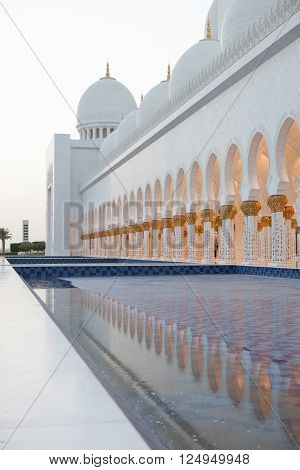 The beautiful white and gold Grand Sheikh Zayed Mosque at sunset, Abu Dhabi, United Arabic Emirates