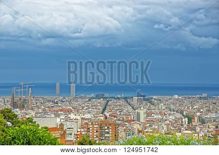 Barcelona, Spain - August 13, 2010: Panoramic view to Sagrada Familia and the Mediterranean sea in Barcelona in Spain. It is called in English as Basilica and Expiatory Church of Holy Family. It was designed by Antoni Gaudi