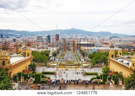 Plaza de Espana and Venetian towers on Montjuic in Barcelona in Spain. Placa Espanya is one of the most important and well-known squares in Barcelona. It is placed at the foot of Montjuic mountain