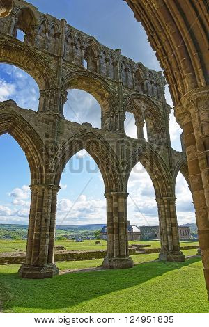 Ruined walls of Whitby Abbey in North Yorkshire in England. It is ruins of the Benedictine abbey. Now it is under protection of the English Heritage.