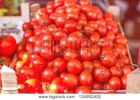 Fresh Red Tomato heap on the marketplace.