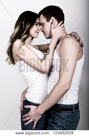 Young and passionate couple in love. Lovers. Couple in love embracing. Sexy beauty couple hugging and kissing.