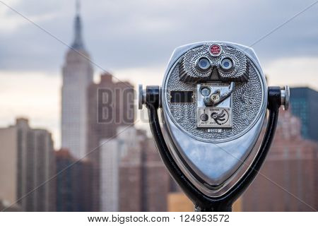 Binoculars looking at out of focus midtown Manhattan in New York City