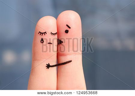 Finger art of displeased couple. Woman cries, man reassures her. He kisses and hugs her.