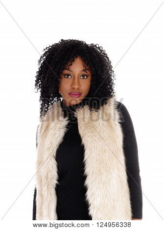 A lovely young African American woman in a black dress and a white