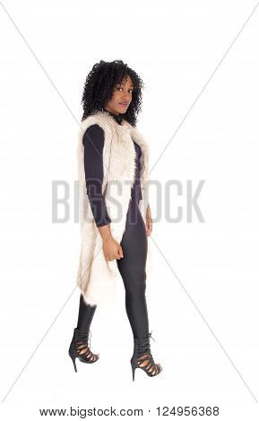 A young African American woman in black tights and a white