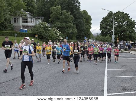 TURKU, ABO FINLAND ON JUNE 29 2013. View of participants in the Paavo Nurmi Marathon 2013 on June 29, 2013 in Turku, Abo Finland. Unidentified people running in the street. Editorial use.