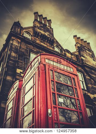 A Vintage British Phonebox In A British City (Edinburgh) Against Stormy Sky