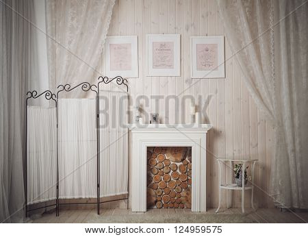 Home interior with white fireplace pictures and candles. Stock photo