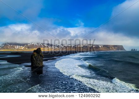 black beach in Iceland during winter, it is called the Vik beach