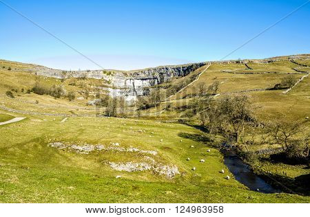 Malham Beck and Cove, North Yorkshire England, with a patchwork of dry stone walls.