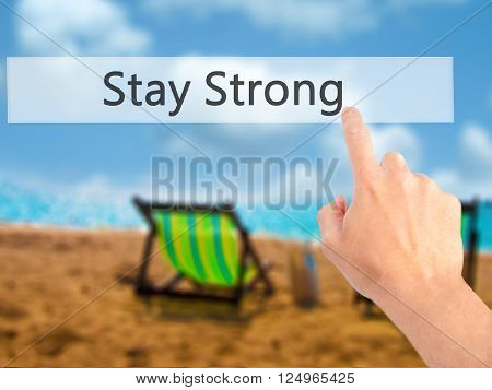 Stay Strong - Hand Pressing A Button On Blurred Background Concept On Visual Screen.